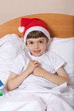 Boy of six years in the bed stock images