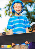Boy with Skate Board Stock Images