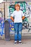Boy with skate board at the skate park Stock Image