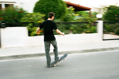 Boy on skateboard. During movement Stock Photo