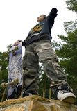 Boy with Skateboard. Teenager in Camouflage with Skateboard at Park Stock Images