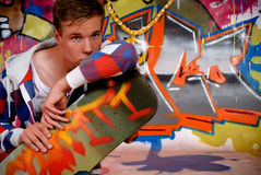 Boy skateboard, graffiti wall Stock Photo