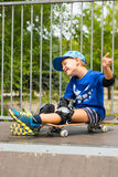Boy on Skateboard Making Excited Hand Gesture Royalty Free Stock Photos