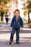 Boy with skateboard in park Royalty Free Stock Photography
