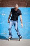 Boy with skateboard. In skate park Royalty Free Stock Photo