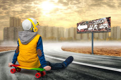 Boy on a skateboard,skate on the road.The little boy in the style of Hip-Hop .The Young Rapper.Cool rap DJ.Children`s fashion. The little boy in the style of stock image