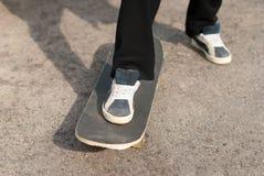 Boy on a skateboard sneakers. Royalty Free Stock Photos