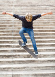 Boy skateboarding. Teen boy skateboarding on stairs Stock Image