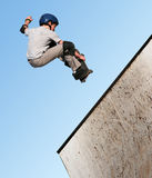 Boy skateboarding. Boy jumping on a skateboard royalty free stock photography