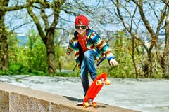 Boy skateboarding in the city Park . The concept of sport and recreation for children stock image