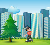 A boy skateboarding near the high buildings Stock Photos
