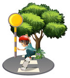A boy skateboarding near the tree Royalty Free Stock Images