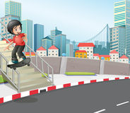 A boy skateboarding at the street near the stairs Royalty Free Stock Photography