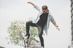 Boy skater is doing stunt at the street royalty free stock photos
