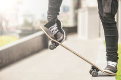 Boy skater is doing stunt at the street stock image