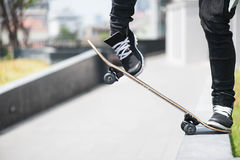 Boy skater is doing stunt at the street royalty free stock photo