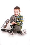 Boy with skates, insulated background Stock Photography