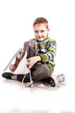 Boy with skates, insulated background Stock Photo