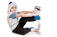 Boy with skates, insulated background Stock Images