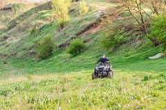 The boy skates on a quad bike in a beautiful area stock image