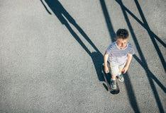 Boy skates on skate board - city sport activites stock images