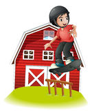 A boy skating in front of the red barnhouse Royalty Free Stock Photos