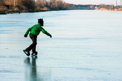 A boy skating on the frozen lake Royalty Free Stock Images