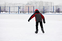 Boy skating rear view Royalty Free Stock Photos
