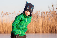 A boy skating on the river Royalty Free Stock Photo