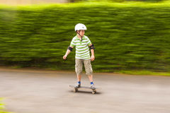Boy skating with speed Royalty Free Stock Photography