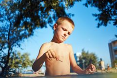 Boy with sketch pen drawing Stock Images