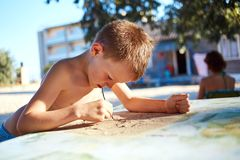 Boy with sketch pen drawing Stock Photography