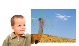Boy sketching a greener future. Boy sketching a green future - concept for environment and nature conservation Royalty Free Stock Photos