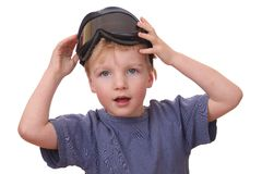 Boy with ski goggles. Portrait of a young boy wearing ski goggles isolated on white background Royalty Free Stock Image