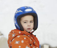 Boy in ski helmet, at winter vacation Royalty Free Stock Photos