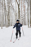 Boy ski running in winter forest Royalty Free Stock Photography