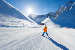 Boy on ski-track skiing view from back in Sochi Stock Photo