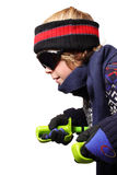 Boy skiing. Isolated shot of a boy crouching holding ski poles Royalty Free Stock Photos