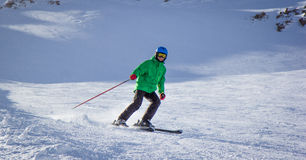 Boy skiing in the mountains Royalty Free Stock Photo