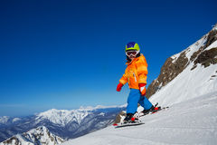 Boy skiing in winter with beautiful mountains Stock Photo
