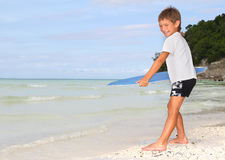 Boy with skim board on sea background Royalty Free Stock Photography