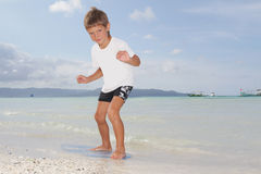 Boy with skim board on sea background Royalty Free Stock Photo