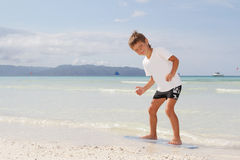 Boy with skim board on sea background Stock Photography