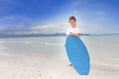 Boy with skim board on sea background Stock Image