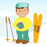Boy with skis drinking coffee. Royalty Free Stock Image