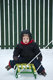 Boy on the sled Royalty Free Stock Photos