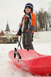 Boy with sled Stock Photos