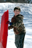 Boy with sled Royalty Free Stock Photo
