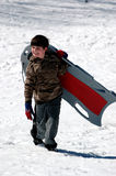 Boy with sled Stock Image