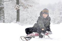 Boy on a sled Royalty Free Stock Photos